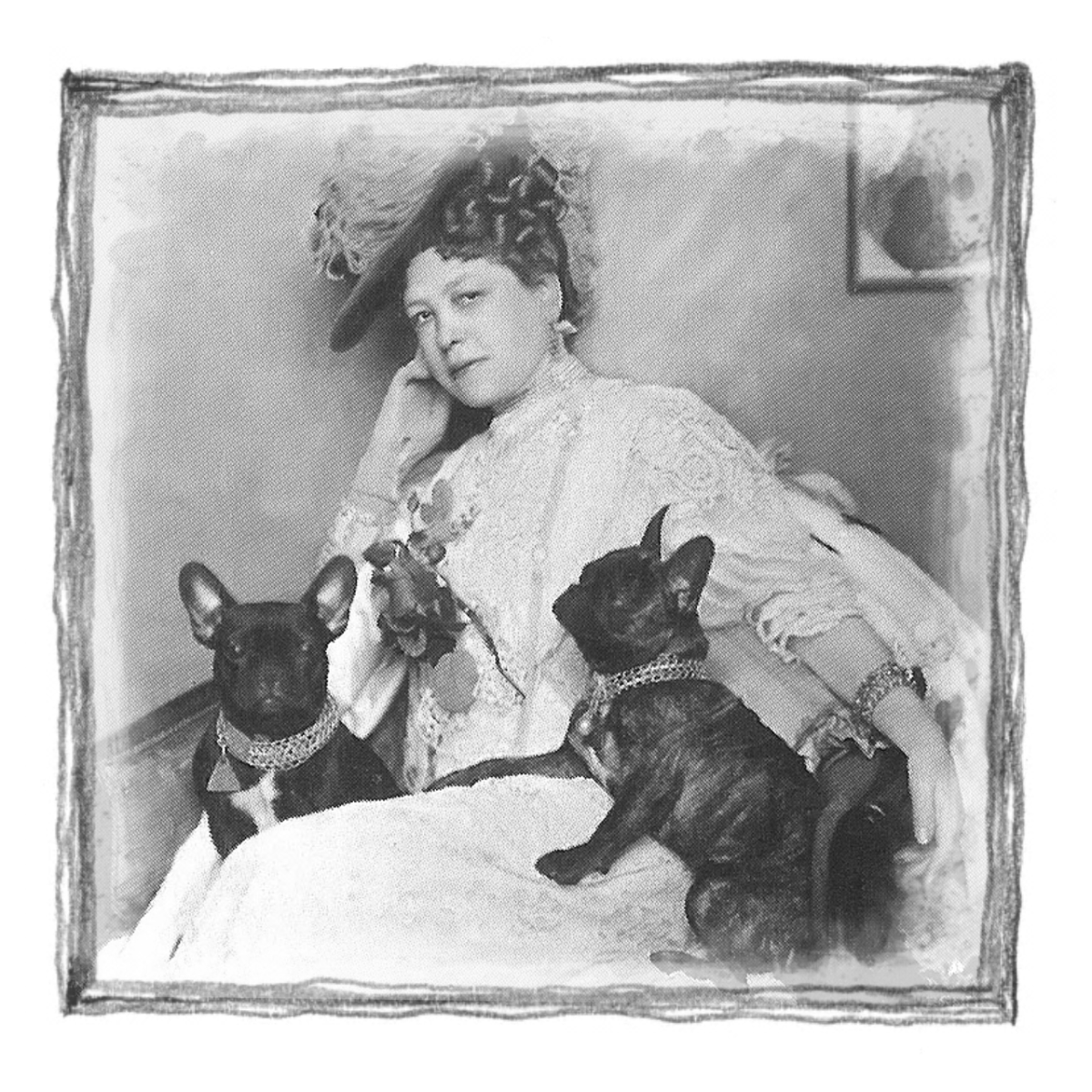 A photo of Esther Flint with her two French Bulldogs. Esther lived in our house but died in the early 1900s.