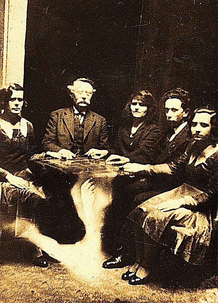 "An early 1900's seance, where the term ""telekinesis"" was born."