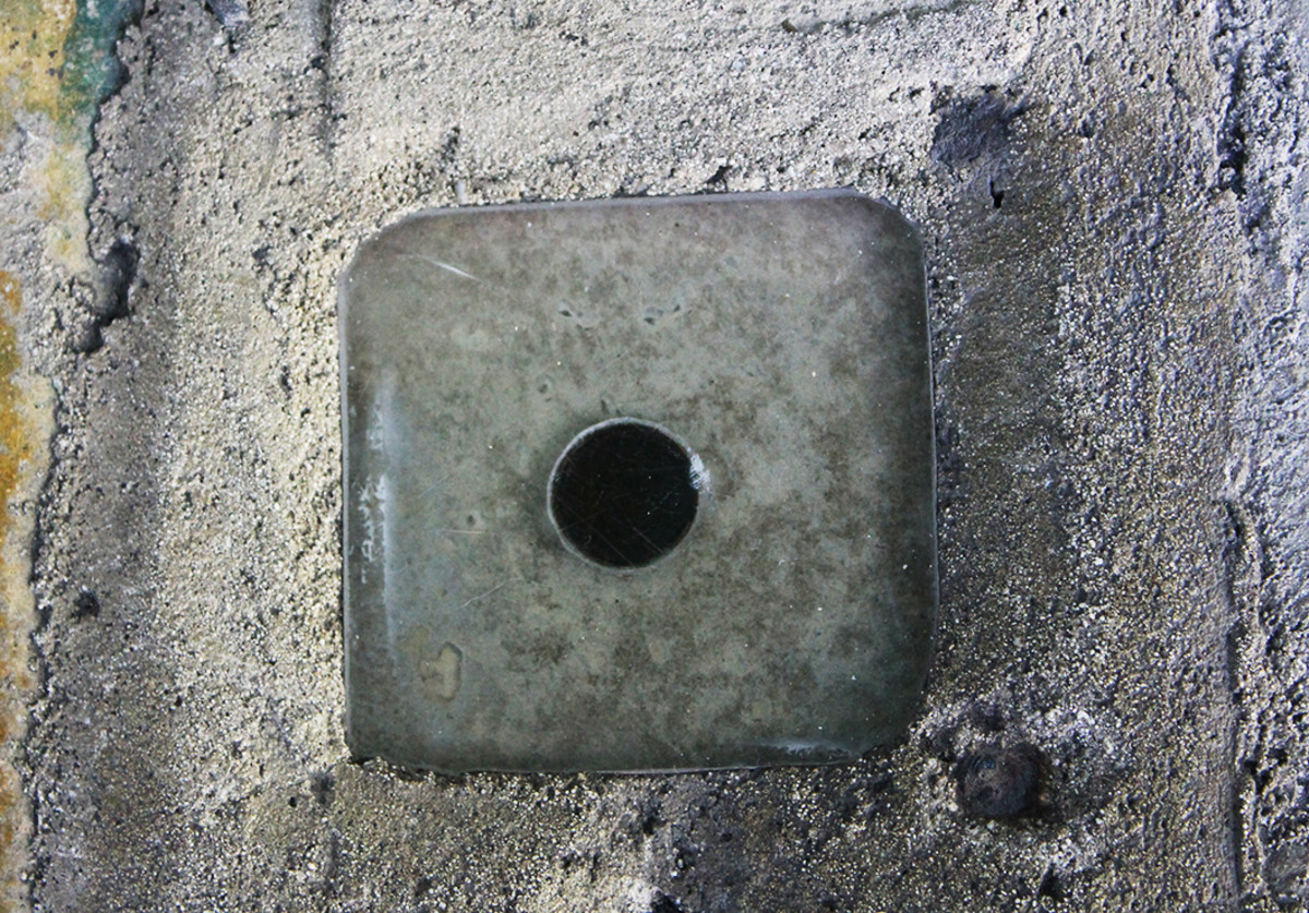 The penny embedded in the cement on the north side of the pool at Hemingway House.