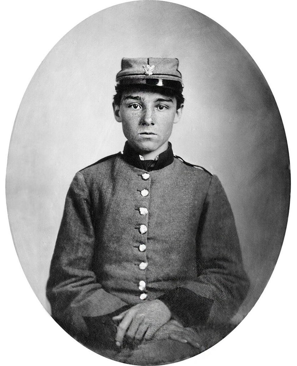 A young soldier of the Civil War wearing a kepi hat.