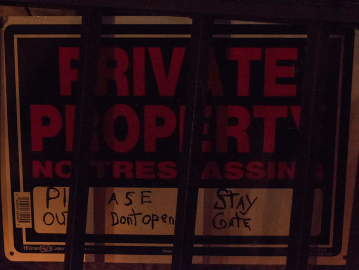 "The ""Private Property, No Trespassing"" sign currently posed outside of Franklin Castle by the current owners."