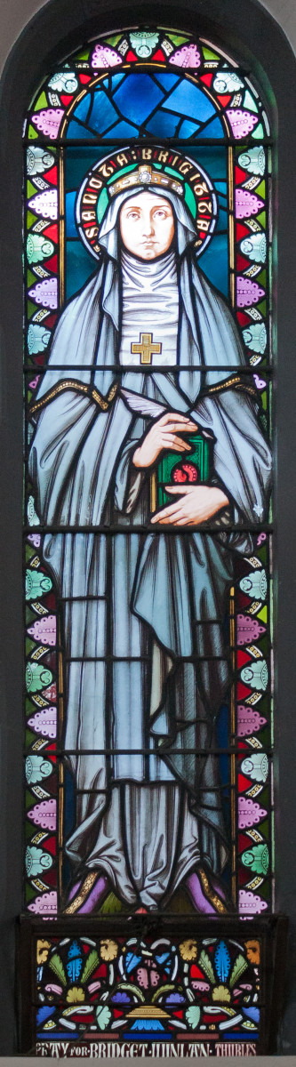 21st stained glass window in the ambulatory depicting Saint Brigid. Manufactured by Wailes of Newcastle.