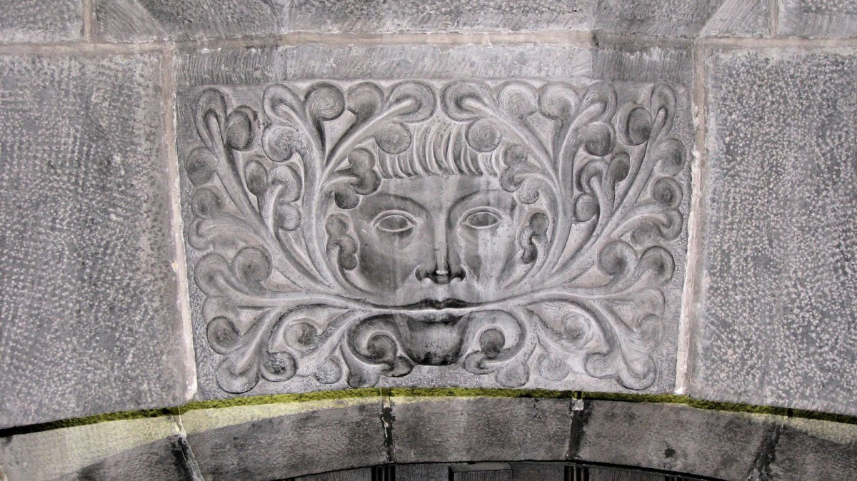 The pagan Greenman who guards the entrance to the crypt, the oldest part of the cathedral in Gent Belgium.
