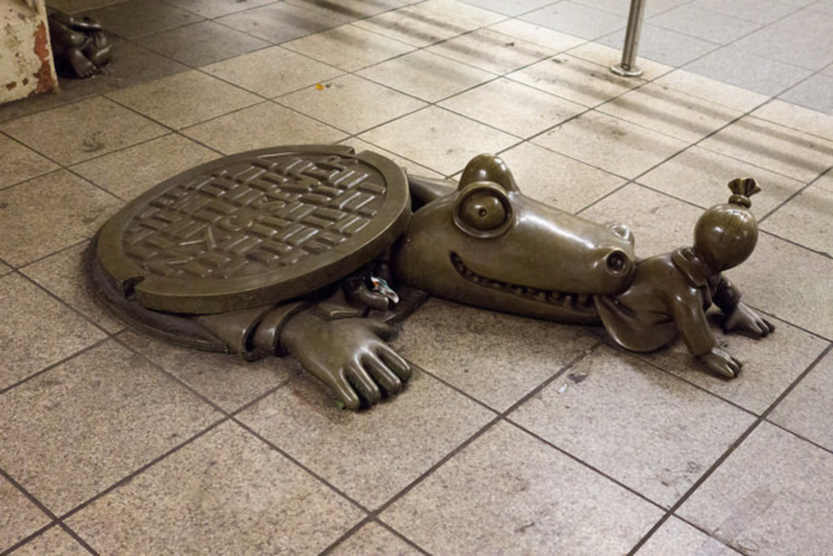 Tom Otterness's sculptures are dedicated to the legend of sewer alligators, this one can be found at 14th St./Eighth Ave. station.