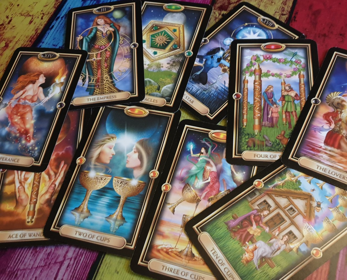 Tarot cards are like magical magnifiers in spellwork. These cards are from the Gilded Tarot.