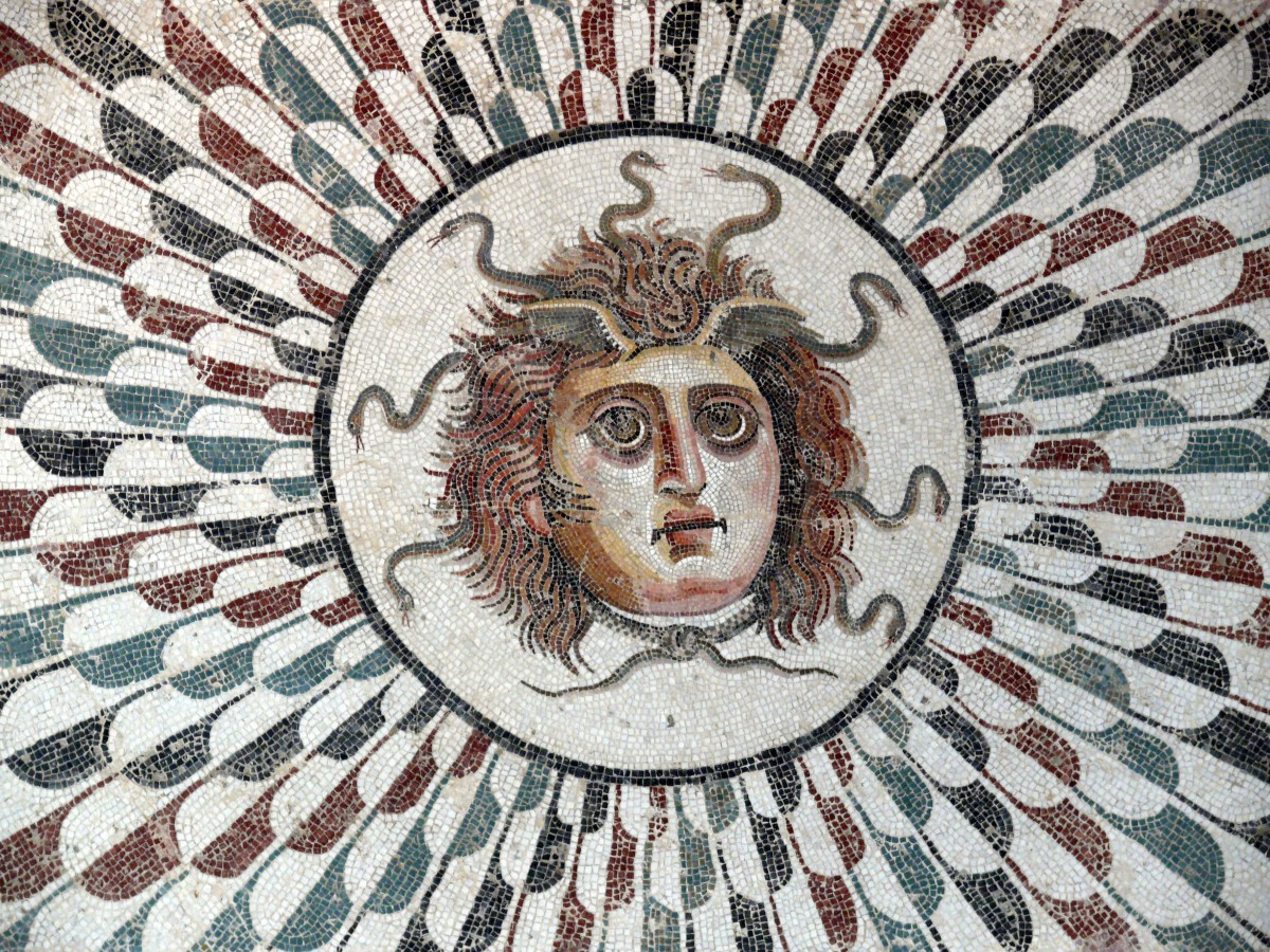Ancient mosaic depicting Medusa, a mythical being with venomous snakes for hair.