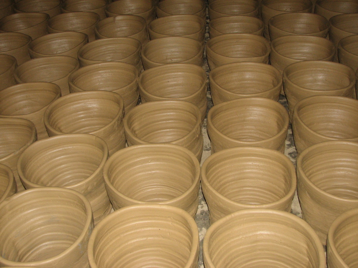 lines of clay jars at Burnayan / the Vigan House of Pottery