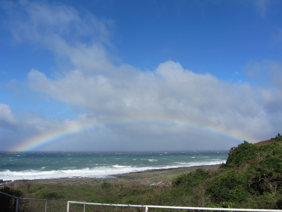 Updated photo as of 2014, rainbow near the sea shore to Kapurpurawan Rock Formation