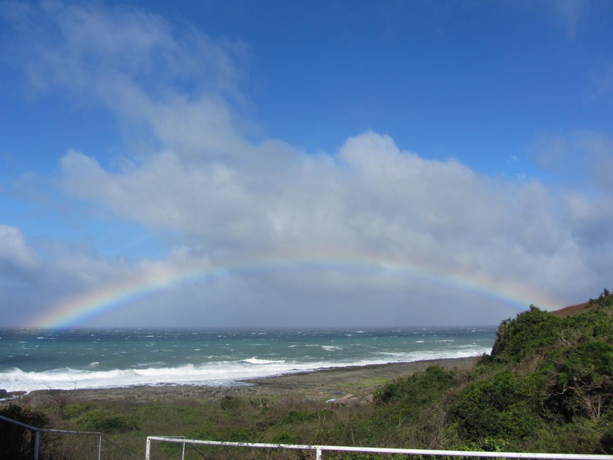 Updated photo as of 2014, rainbow near the sea shore to Kapurpurawan Rock Formation
