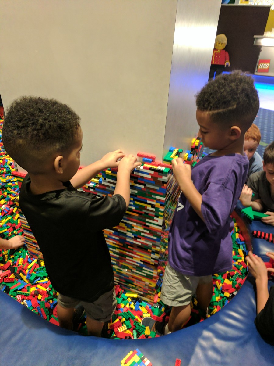 There's a huge Lego pit for kids to play while parents check in.