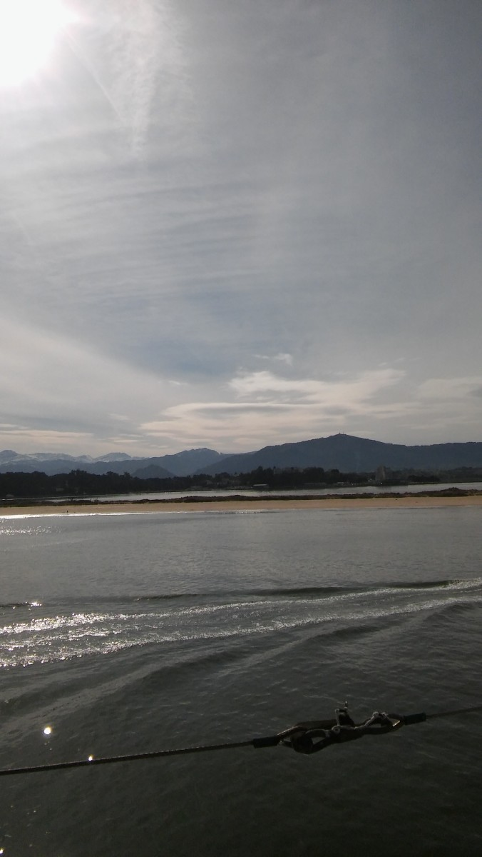 Santander Beach with mountains in the background.