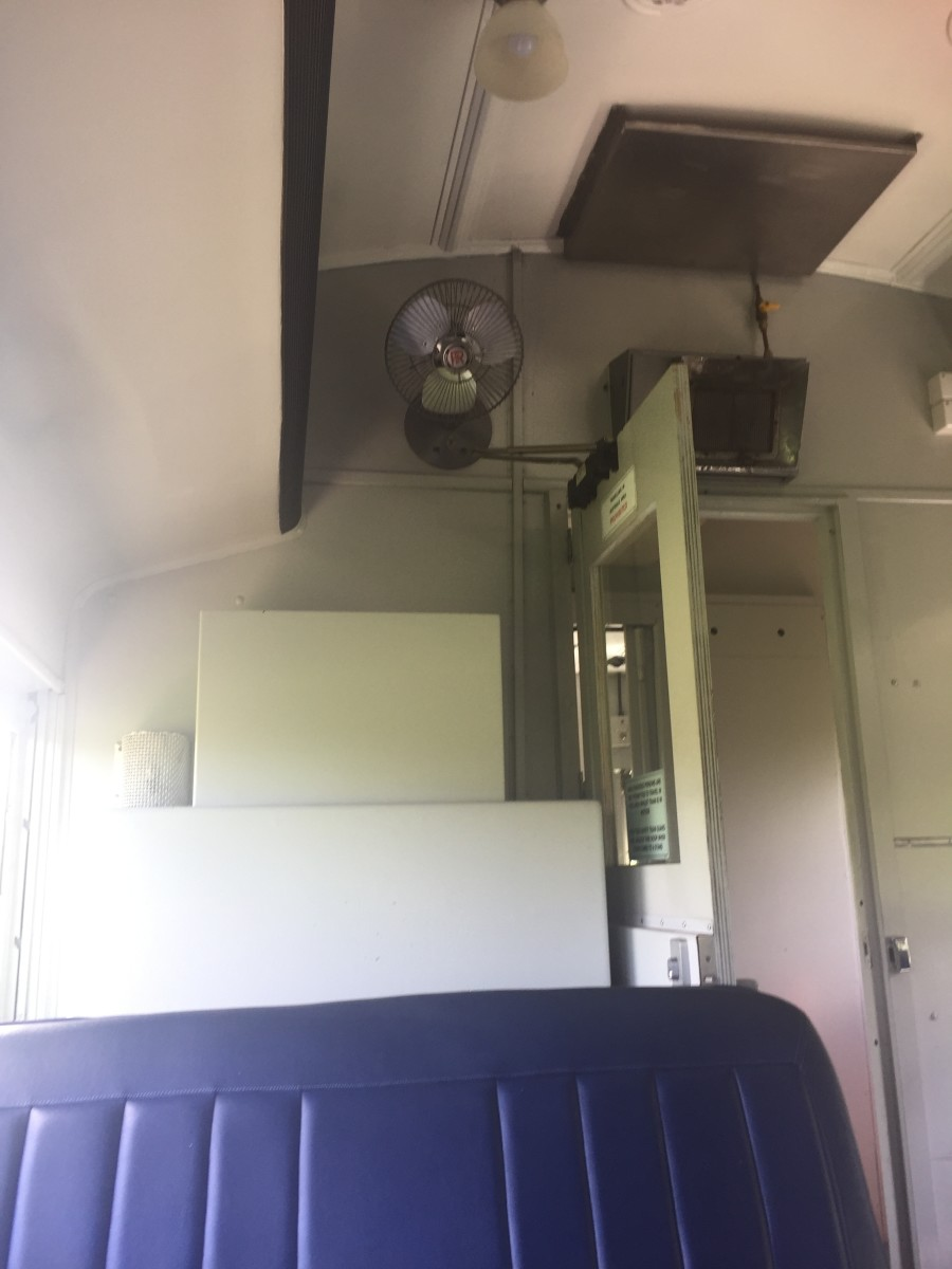 The carriage with the blue seats originally carried 'first class' passengers. There's nothing fancy about the fan, the heater and the light compared to the 'economy' carriage. However the seats are much more comfortable.