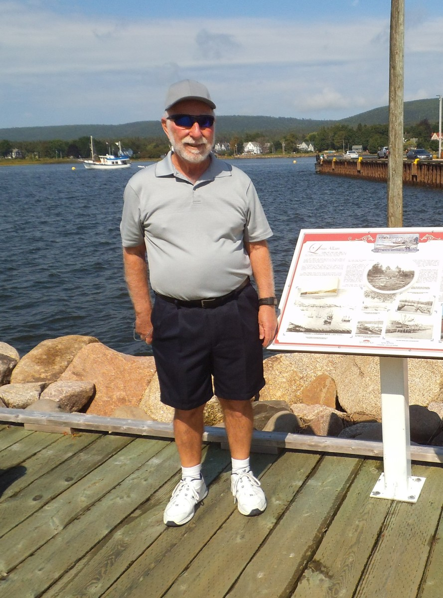 Read the plaques along the boardwalk for the history of the Acadians at Annapolis Royal. Here's my husband next to a plaque about his 6th great-grandfather.