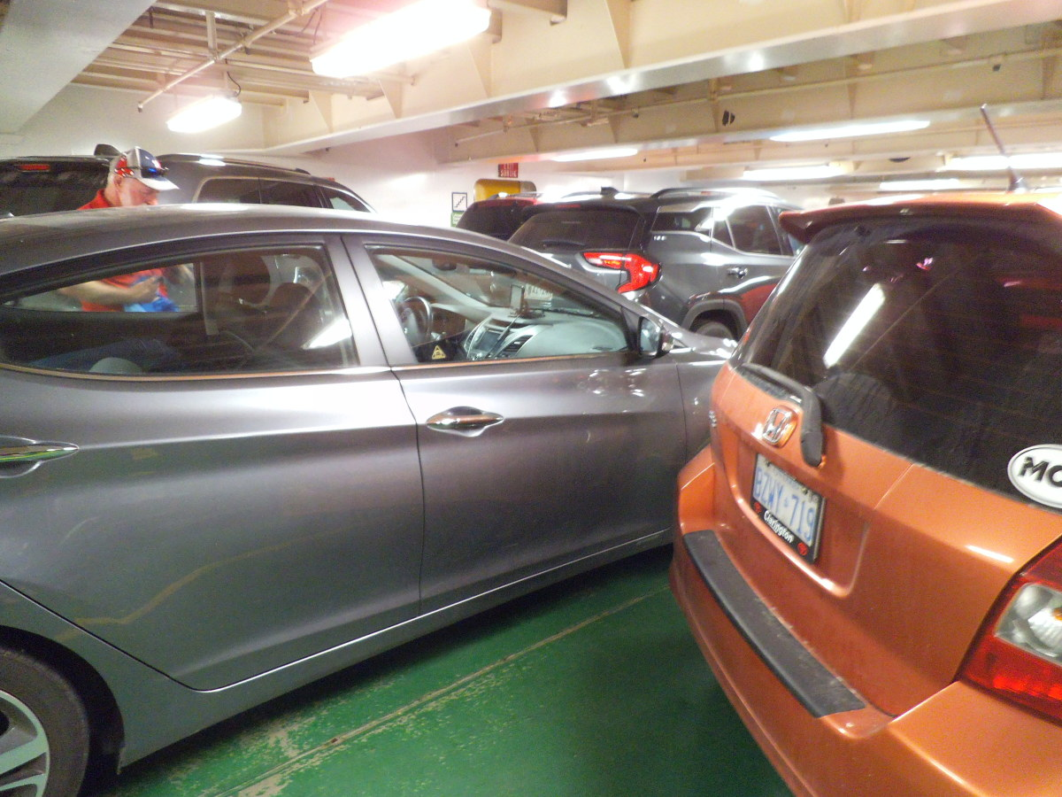 Cars are tightly packed inside the lower levels of the ferries.
