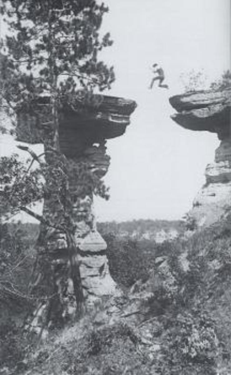 A famous H.H. Bennett's stop-action photo of his son Ashley leaping to Stand Rock in 1886.