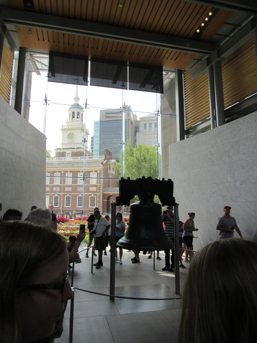 The Liberty Bell showing Independence Hall in the background. August 2018.
