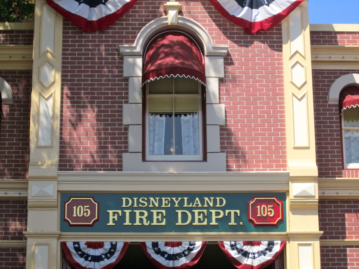 The light in Walt's apartment window above the fire station on Main Street USA.