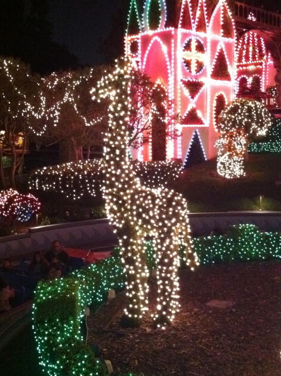 All the bush animals are decorated in colored lights.