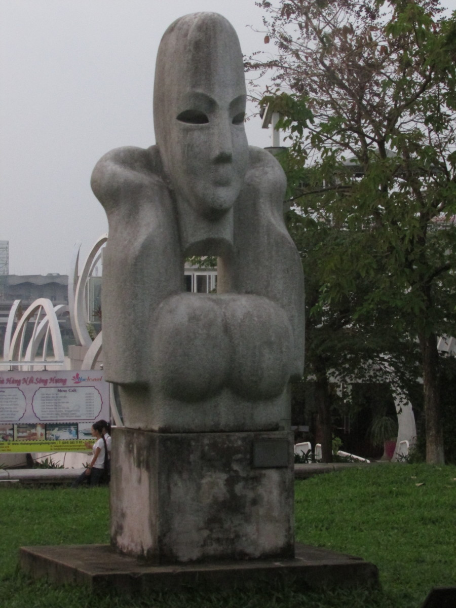 Statue by riverbank of Perfume River, Hue
