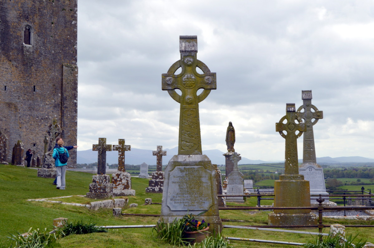 The castle known as Rock of Cashel dominates the countryside. The cemetery adds a somber air.