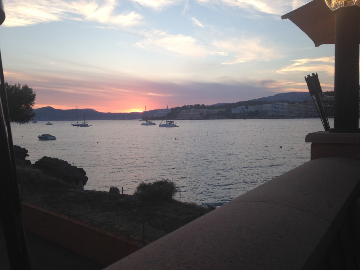 A view of the sunset over Santa Ponça bay from the Meson Del Mar.