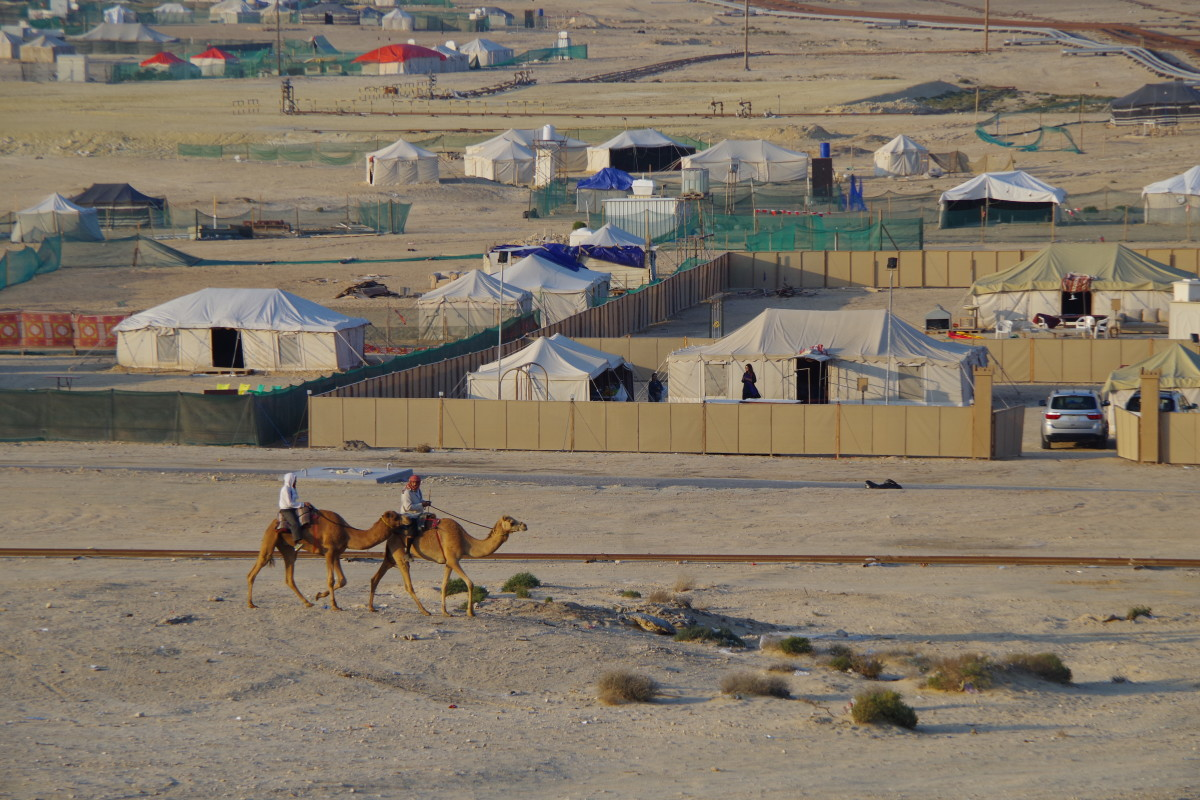 A view from the mid-way point of the hill. Camels walk pass by our camp in the background (December 2015).
