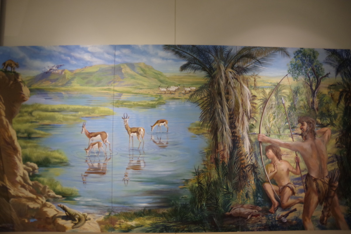 A painting depicting early hunters of the region and prey animals.