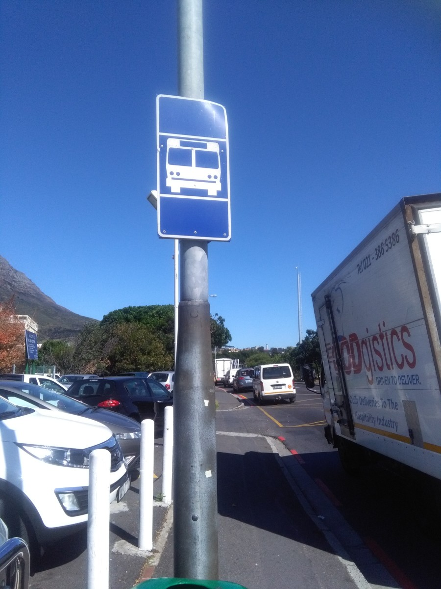 This blue signpost indicates it is an area in which the bus will stop. Sometimes there is just a number of it.