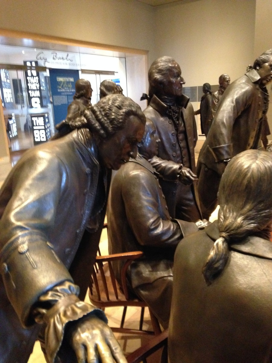 Representatives from each colony in bronze inside the Constitution Center, positioned as they were when they ratified the most important document in our history.