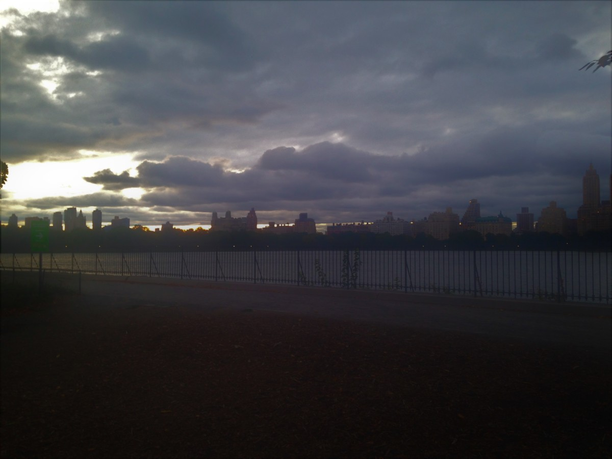 The view of the sunset over New York City from the Jacky Onassis Kennedy Reservoir in Central Park.