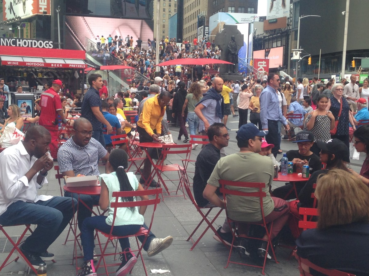 A Typical day at Duffy's Square in the Middle of Times Square where hundreds of thousands of people of all colors and shapes pass by daily.