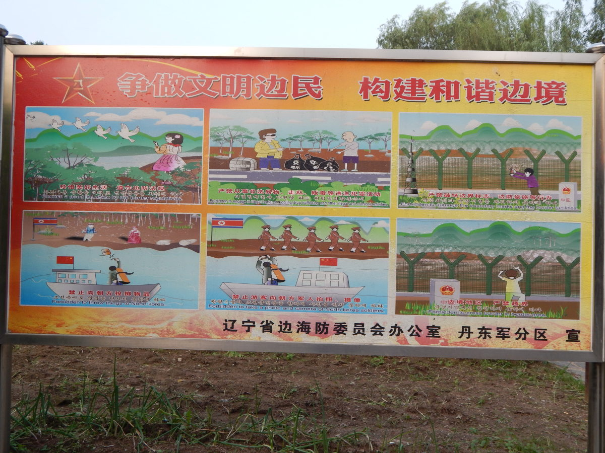 A sign along the trail with border rules such as 'forbidden to throw things to North Korea' and 'forbidden to cross the border'.
