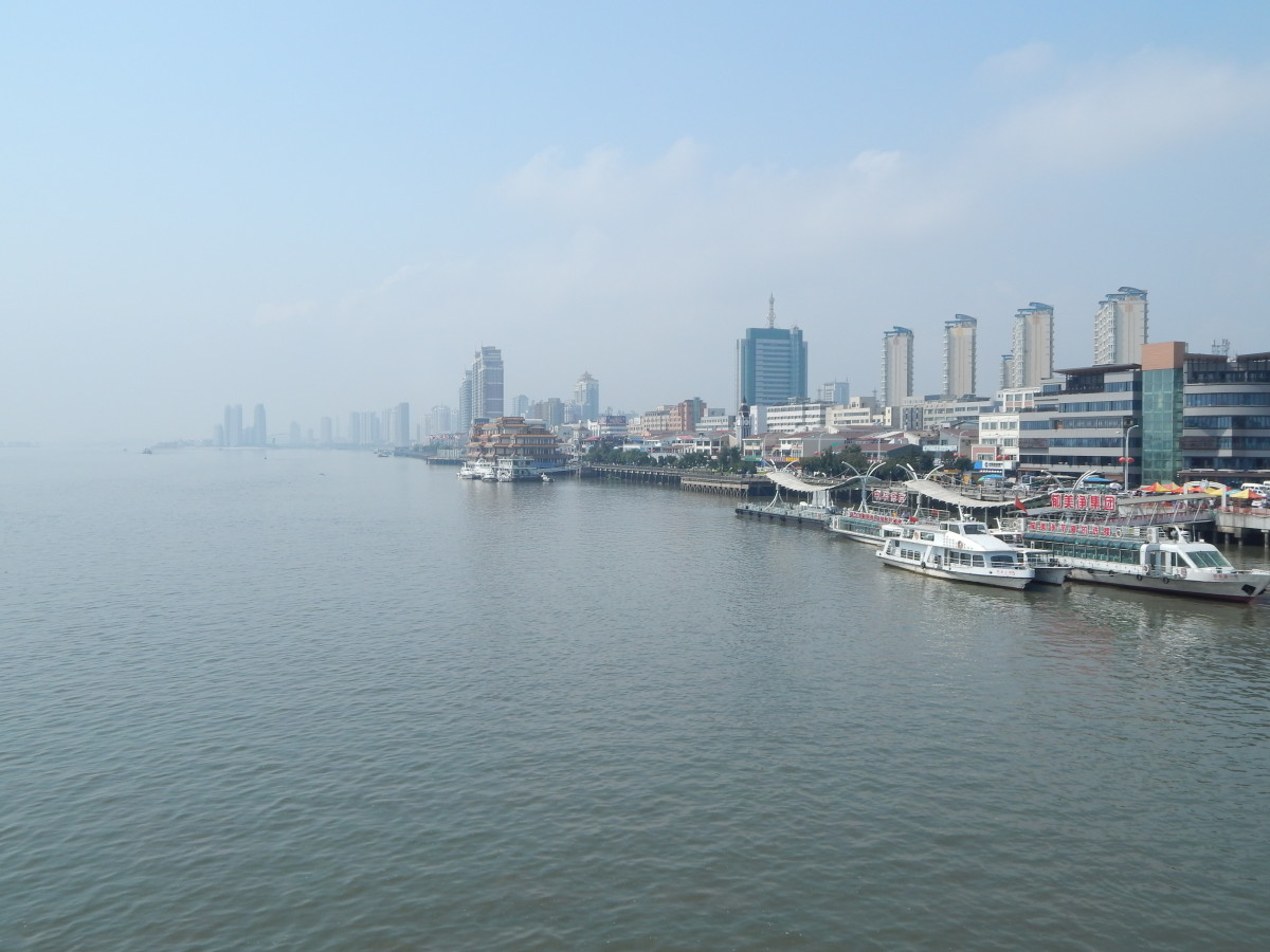 Here is the view along the Chinese side of the river. It's busy with street hawkers, tourists and boats and is in complete contrast to the opposite side of the river. This is a great spot to find a restaurant and try out some North Korean cuisine.