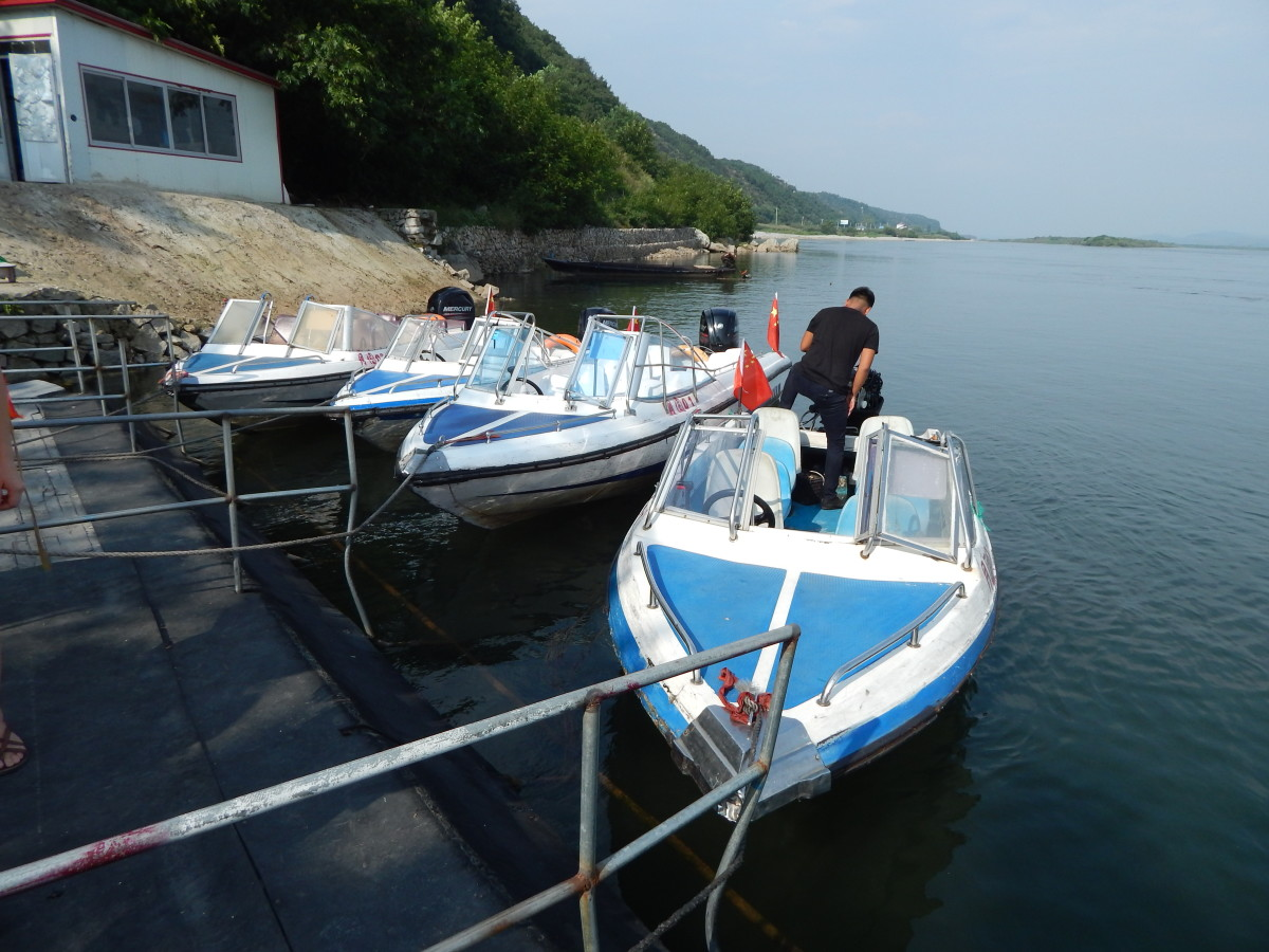 A line of speedboats wait for customers.