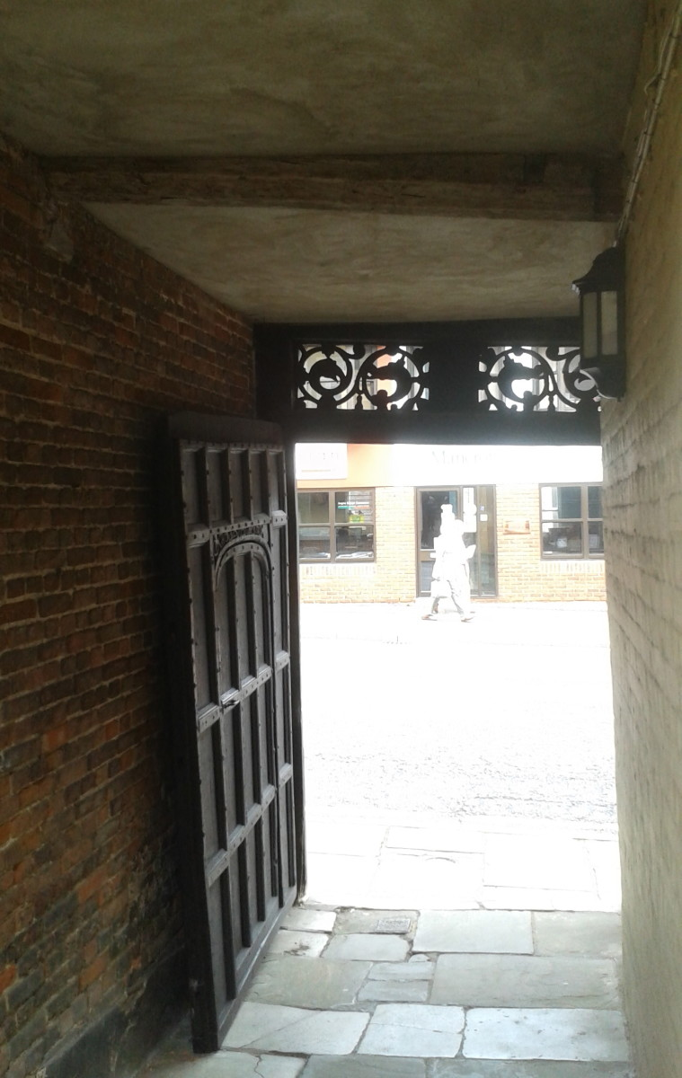Entrance Door and Passage Looking out Onto Street