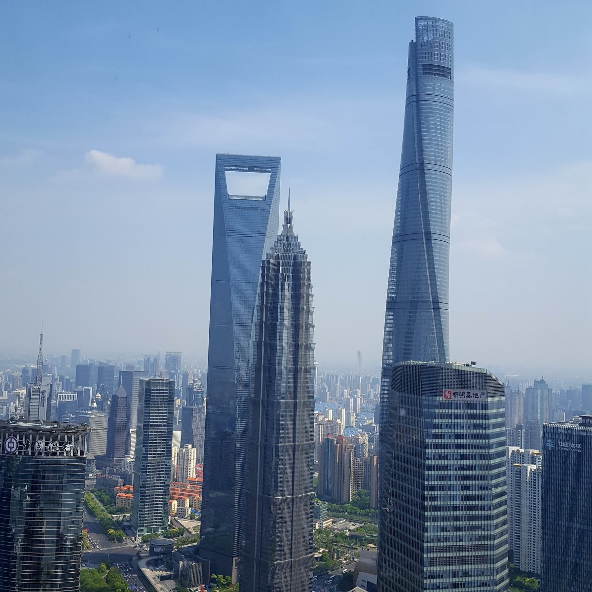Three famous skyscrapers.  Pictured here: Shanghai Tower - now Shanghai's tallest building at 632m tall. Shanghai World Financial Center Jin Mao Tower These three towers also have observation decks that are open to the public.