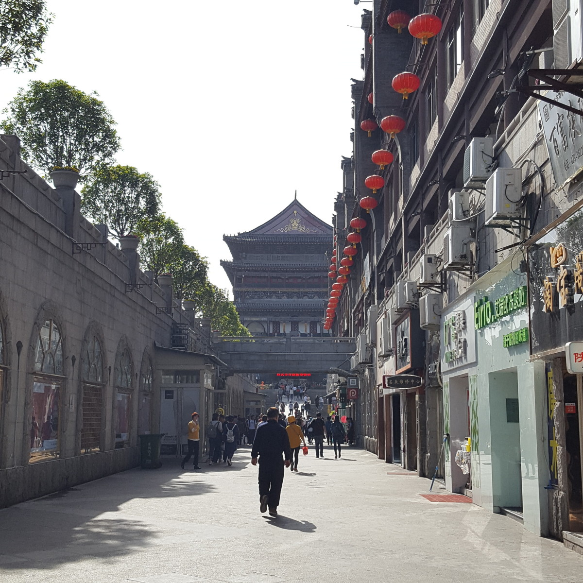 The Drum Tower appears at the end of the street.