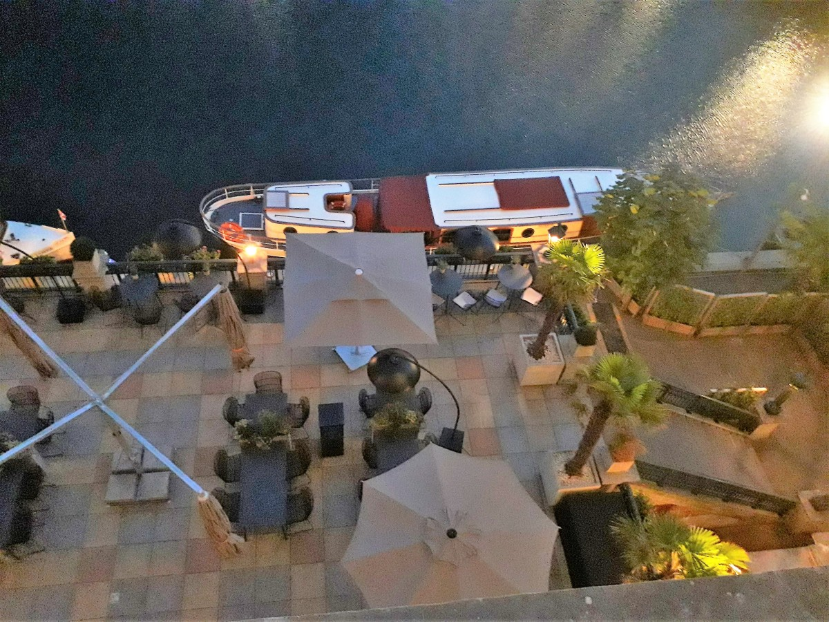 The hotel terrace and launch at night.