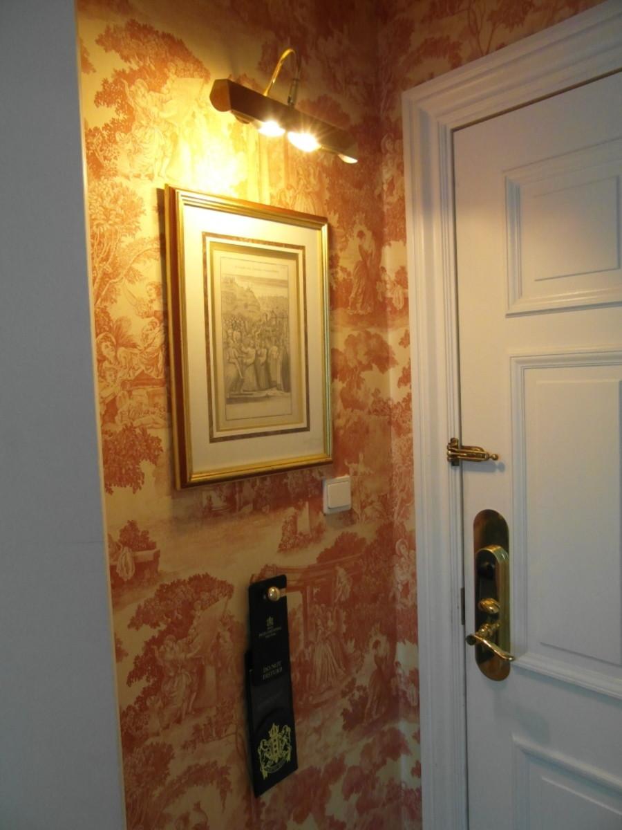 Illuminated print by the door.