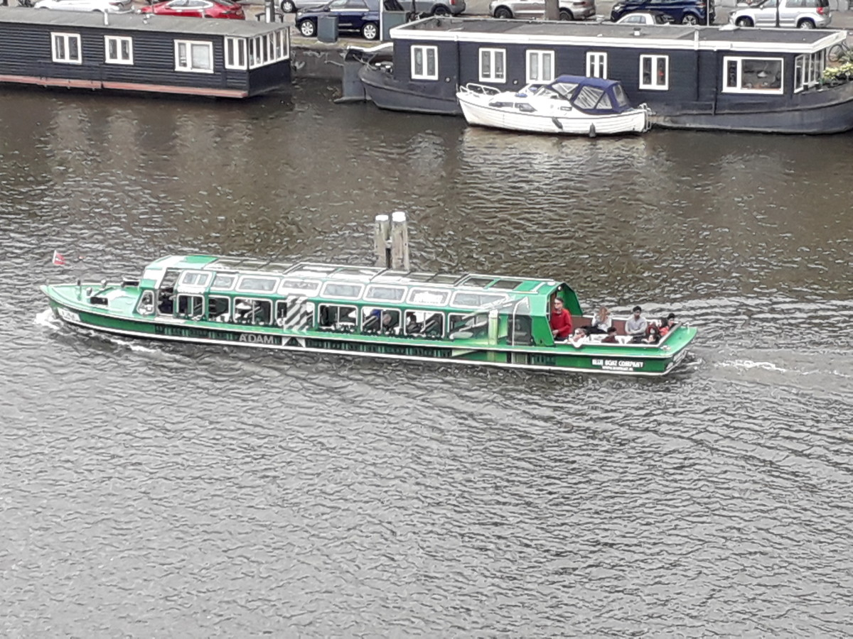 Canal boats regularly pass the Amstel Hotel.