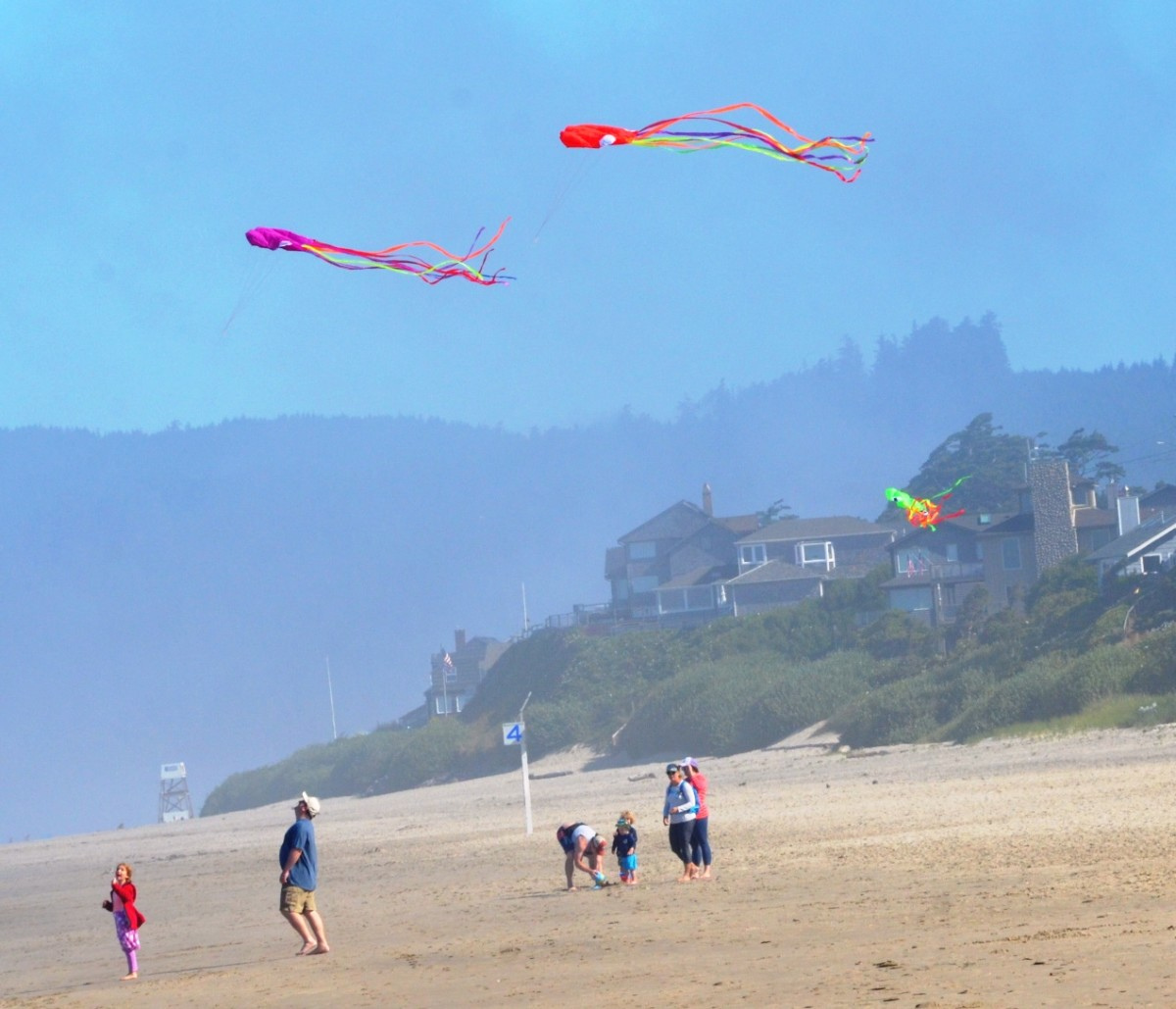 Kids flying kites at Cannon Beach