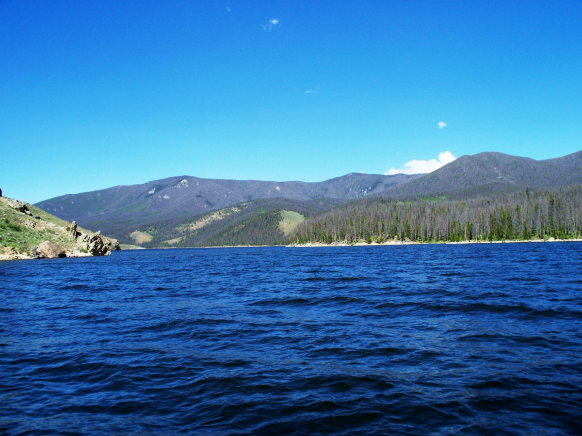 View of Shadow Mountain Lake in Grand Lake, Colorado from a pontoon boat on Grand Lake.