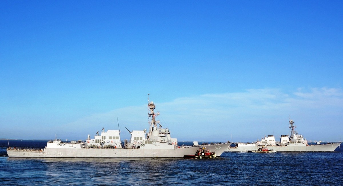 US Navy ships leaving Naval Station Norfolk for Hurricane Irene relief in Norfolk, VA