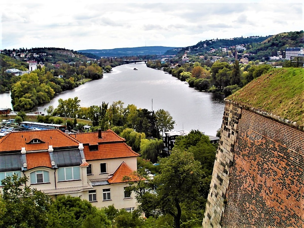 River Vltava with part of the fortress at Vysehrad in the foreground.