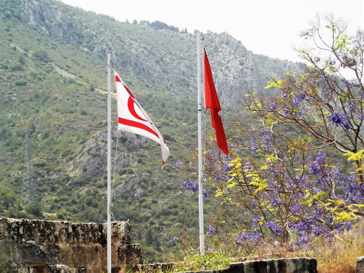 The flags of the Turkish Republic of Northern Cyprus and Turkey fly together.