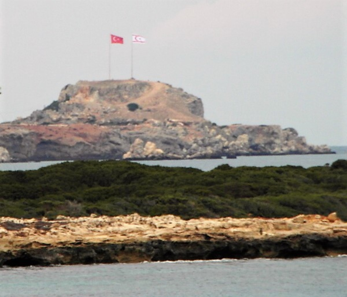 The flags of Northern Cyprus fly at the end of the Karpaz Peninsula.