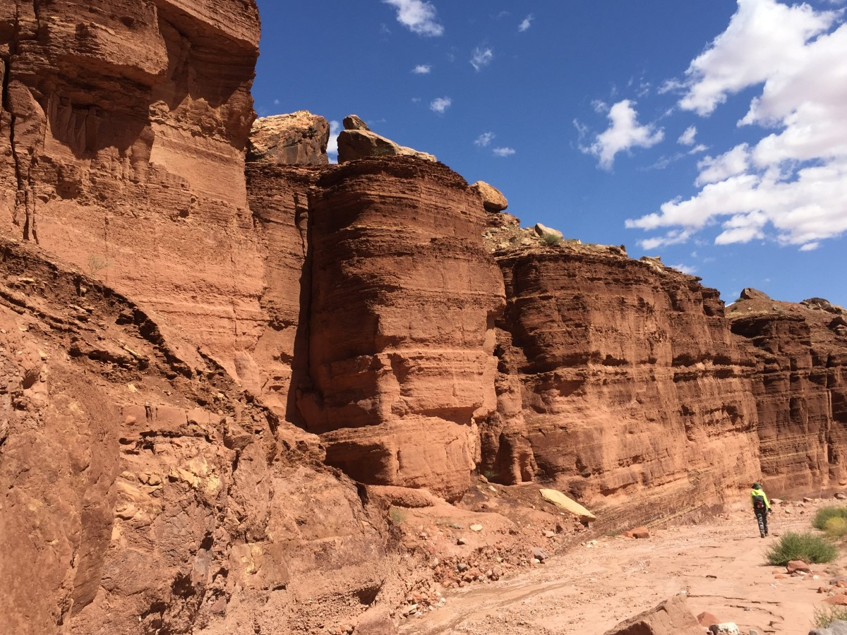 My wife hiking in canyon carved out by Cathedral Wash located north of Navajo Bridge and Cliff Dwellers