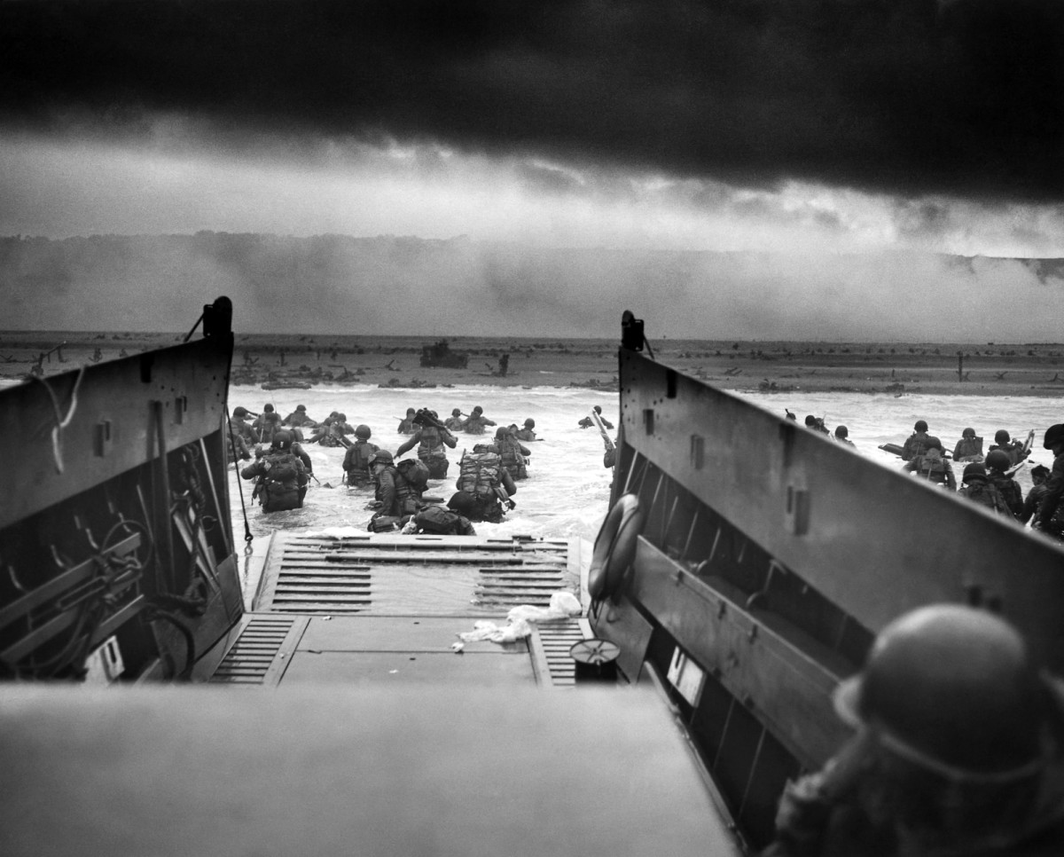 Men of the US 1st Infantry Division wading ashore on Omaha Beach