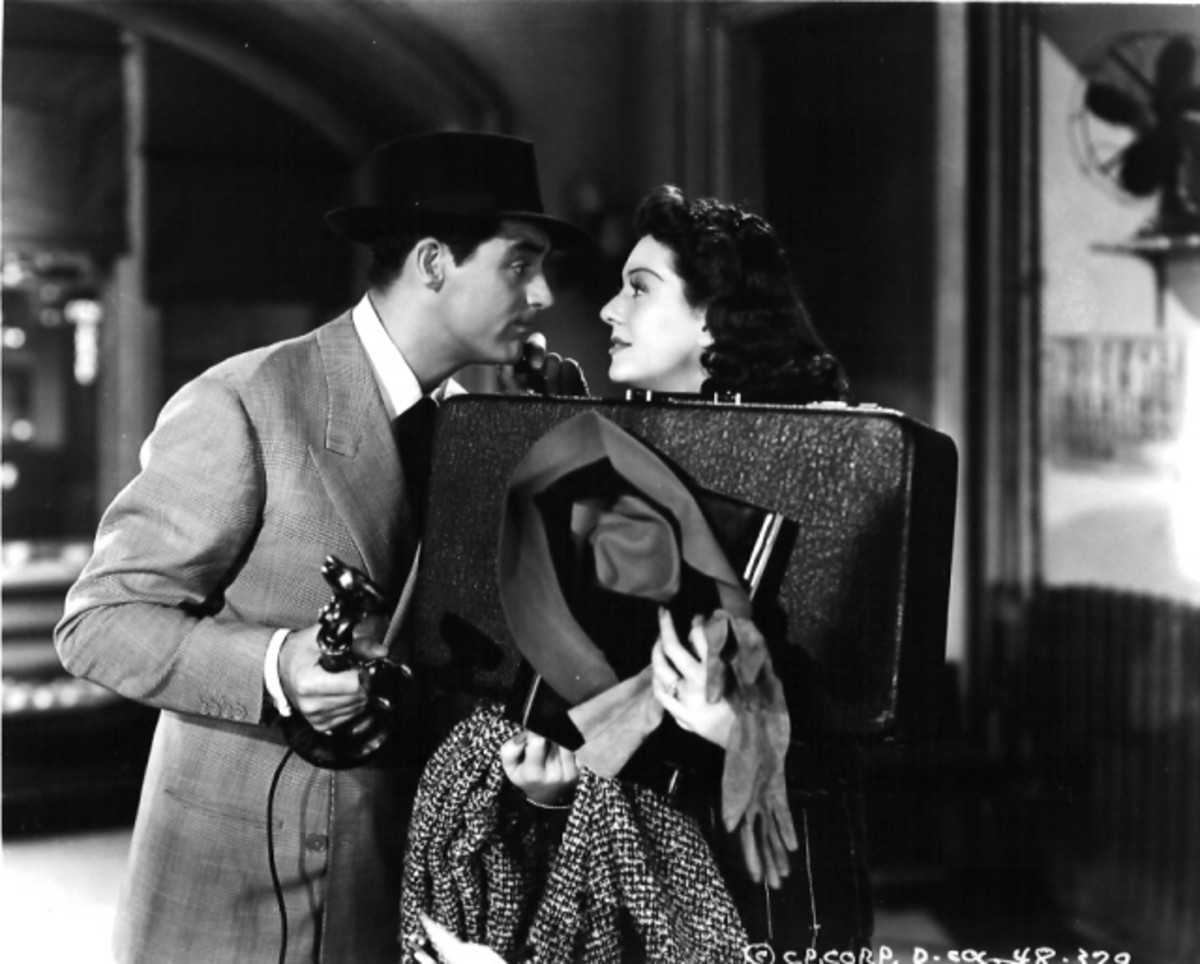 "Cary Grant and Rosalind Russell in the fast-talking comedy ""His Girl Friday."""
