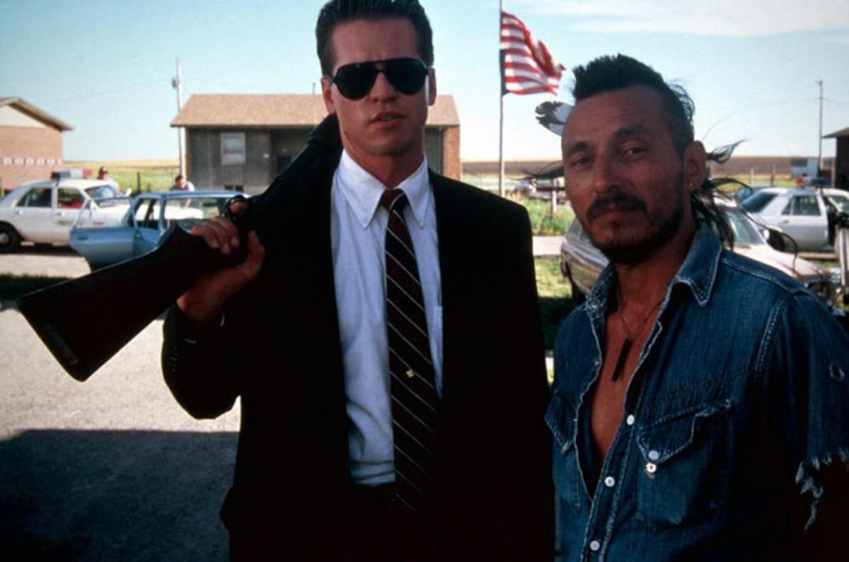 "John Trudell (right) with Val Kilmer in ""Thunderheart"""